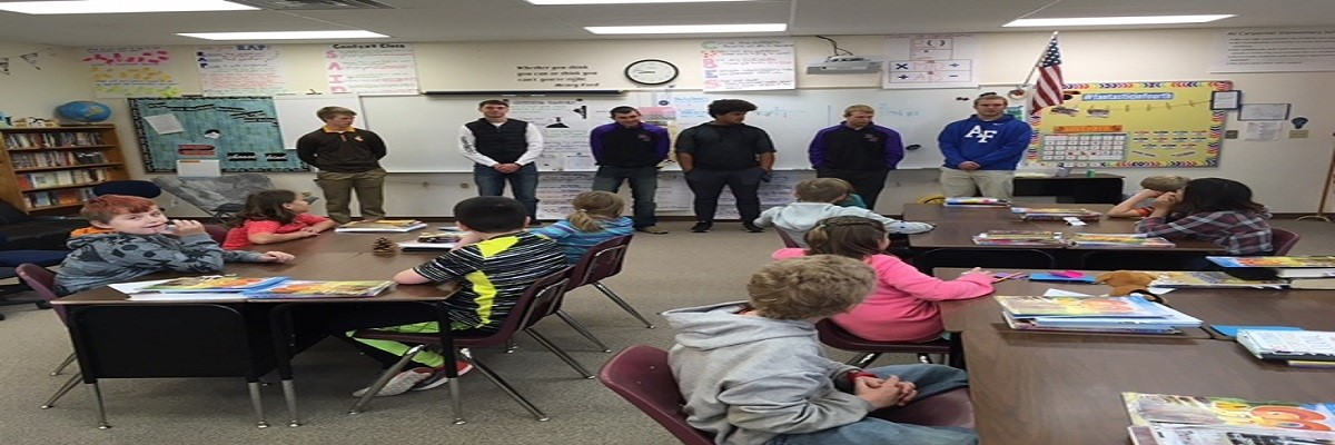 football players talking to students