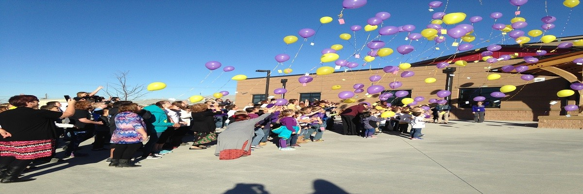 students releasing balloons
