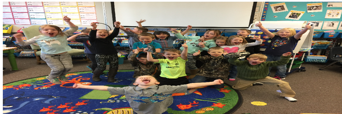 "Ms Sear's 1st graders celebrate the winning of the primary hallway's ""Moose Trophy"""